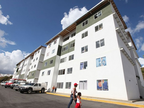 "In response to devastating floods, Venezuelan President Hugo Chavez recently handed over urban housing developments such as this 120-family ""El Morro"" building located in the popular Petare district of Miranda State (Agencies)"
