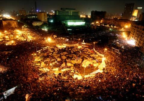 Egyptians celebrate Mubarak's resignation in Tahrir square (AP)