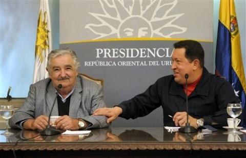 "Uruguayan President Jose ""Pepe"" Mujica and his Venezuelan counterpart Hugo Chavez during their 30 March 2011 meeting in Uruguay (Agencies)."