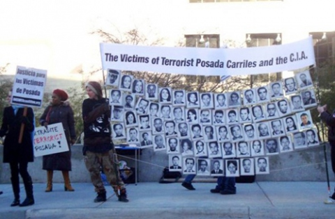 Protesters outside the Carriles trial demand his extradition to Venezuela and the release of the Cuban Five. (Journal Times)