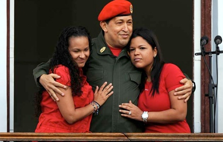 President Chavez and two of his daughters, shortly after his return to Caracas, on the balcony of the presidential palace Miraflores. (Juan Barreto / AFP)