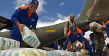 Venezuelan civilian and military personnel help load cargo headed to Somalia (Agencies).