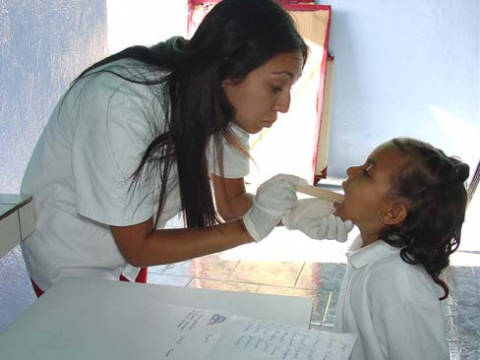 While Venezuelans now have free access to medical care through the government's public clinics, staffed by Cuban medical professionals such as the doctor in this photograph, many people still access private clinics (Agencies).