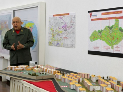 Venezuelan President Hugo Chavez explains the distribution of housing, schools, medical clinics, and green spaces in Venezuela's first socialist city, Caribia (agencies).