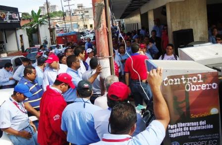"Electricity workers protesting in Carabobo yesterday. The poster in the foreground says ""Worker control- to free us from the capitalist model of exploitation"" (Worker communication team of Corpoelec Carabobo)."