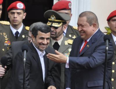 Iranian president Mahmoud Ahmadinejad (left) with Venezuelan president Hugo Chavez, Monday, in Caracas (Feliz Gonzalez).