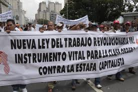"A banner from the National Union of Workers (UNT), demanding: ""New Revolutionary Labour Law Now! Vital Instrument for the Working Class Against Capitalist Rip-Off"". (CdO)"