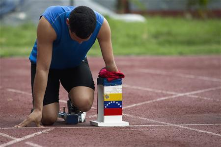 Rubeng Gomez, 26, a member of Venezuela's Paralympics team, trains during a practice session in Caracas April 13, 2012 (Carlos Garcia Rawlins-Reuters)