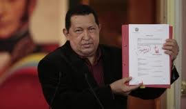 """Chavez signed the law yesterday, writing the phrase """"social justice"""" next to his signature (agencies)"""