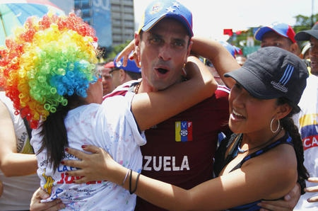 Henrique Capriles with supporters (agencies)