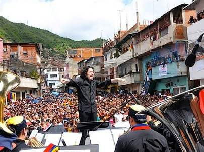 Conductor Gustavo Dudamel leads an orchestra in a barrio in Caracas, Venezuela. The 28-year-old is one of El Sistema's most successful graduates (agencies)