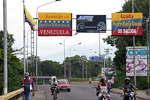 """""""Welcome to the Bolivarian Republic of Venezuela"""" reads the sign on the Venezuelan – Colombian border in Zulia state (EFE)"""