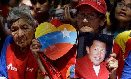 Hugo Chávez supporters gather at Simon Bolívar Square in Caracas, Venezuela, as the president returns to Cuba for further surgery. (Fernando Llano/AP)
