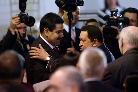 Vice-president Nicolas Maduro (middle left), with President Hugo Chavez, among the press (agencies).
