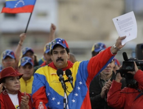 Vice President Nicolas Maduro reads a letter by President Chavez at a rally on Monday