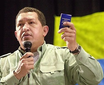 Hugo Chavez holding his Venezuela's constitution (archive)