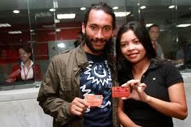 Two people with their new Somos card (AVN)