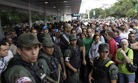 Soldiers outside a Daka store in Caracas (Ariana Cubillos/AP)