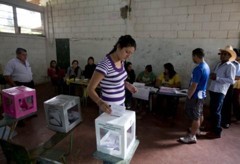 Hondurans voting on Sunday (Eduardo Verdugo/AP)