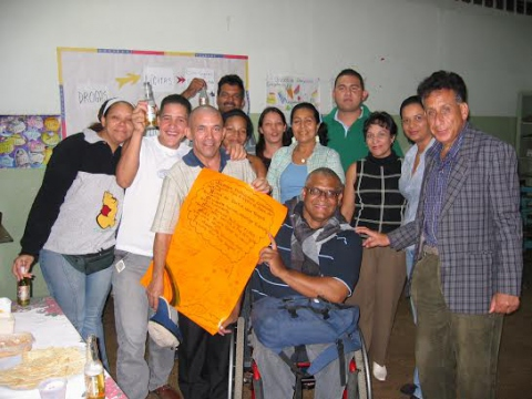 Johnny Moreno (center) teaching a Mision Robinson [literacy] class in El Valle, Caracas. (Sujatha Fernandes)
