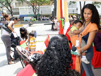 A Venezuelan public media journalist breastfeeds as she works. Motherhood is celebrated in Venezuela with the third longest paid maternity leave worldwide and laws requiring employers to provide job security for new mothers. (blog.chavez)