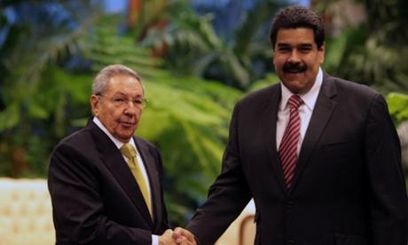 Cuban President Raul Castro, left, shakes hands with his Venezuelan counterpart Nicolas Maduro in Havana, Dec. 14, 2014. (Prensa Presidencial/AVN/Xinhua Press/Corbis)