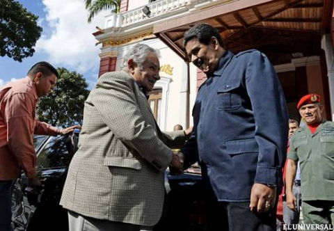 President Maduro meets with Uruguayan leader Pepe Mujica in Caracas, on December 3rd. (AFP)