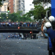 """The streets of Caracas during the coup and the infamous """"Llaguno Bridge"""" (telesur English)"""