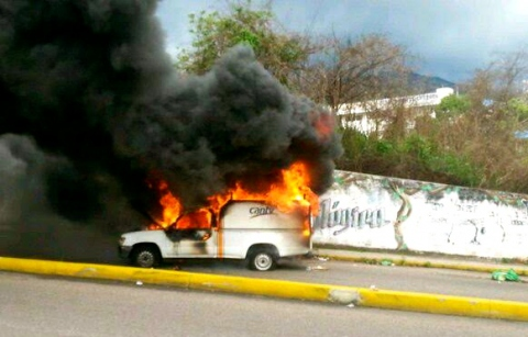 A Cantv truck burns after having been set alight by hooded militants (Sources)