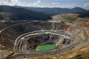 Open-pit mining is widely condemned by environmentalists  for its impacts ecologically and damaging human cost (Archive).