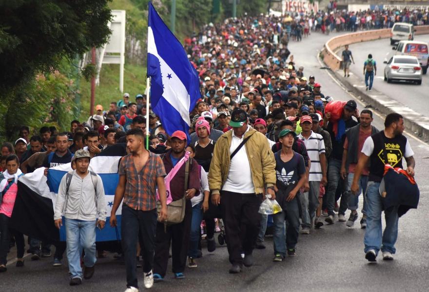A Honduran flag flies at the head of the caravan. (AFP)