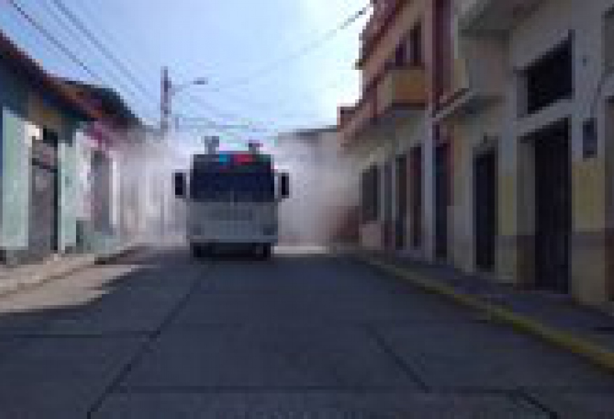 One of 350 newly acquired disinfecting vehicles sprays the empty streets of Merida City, Merida State on Sunday. (@LaBunkeB / Twitter)