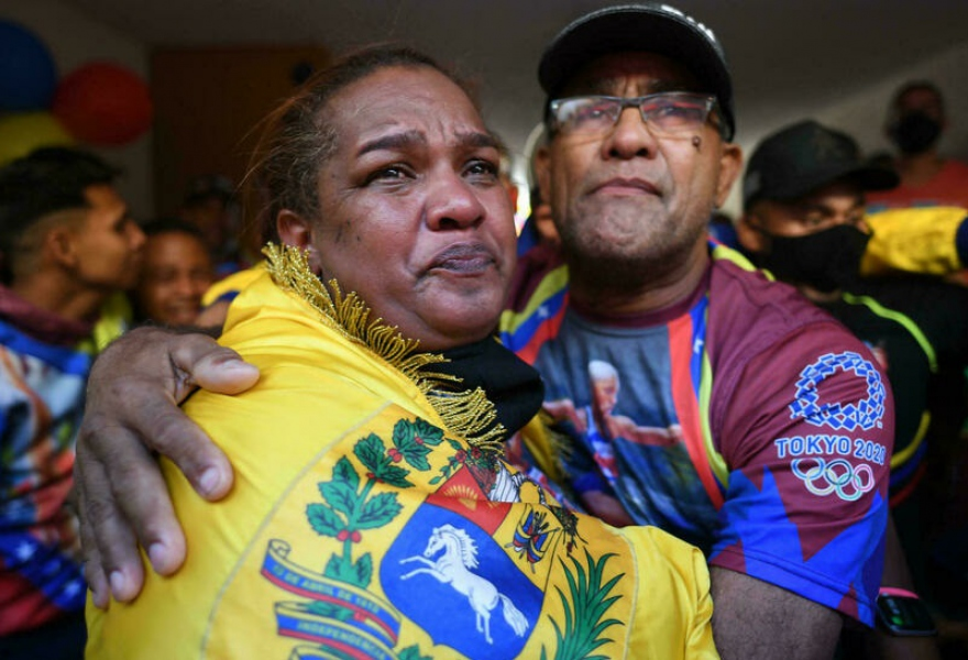 A tearful Yulecsi Rodríguez and Pedro Zapata watched their daughter win gold from Barcelona, east Venezuela. (Federico Parra / AFP)