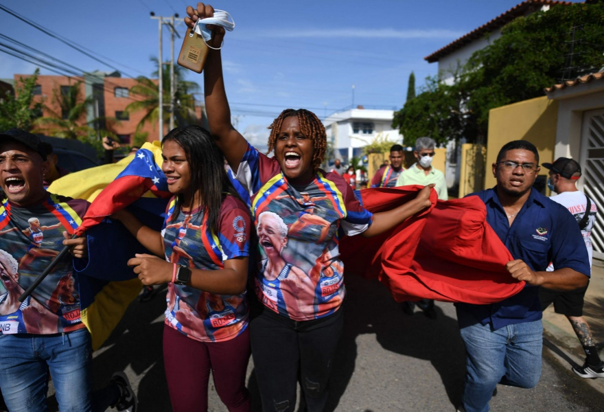 A number of sports fans took to the streets to celebrate Rojas' victory. (Federico Parra / AFP)