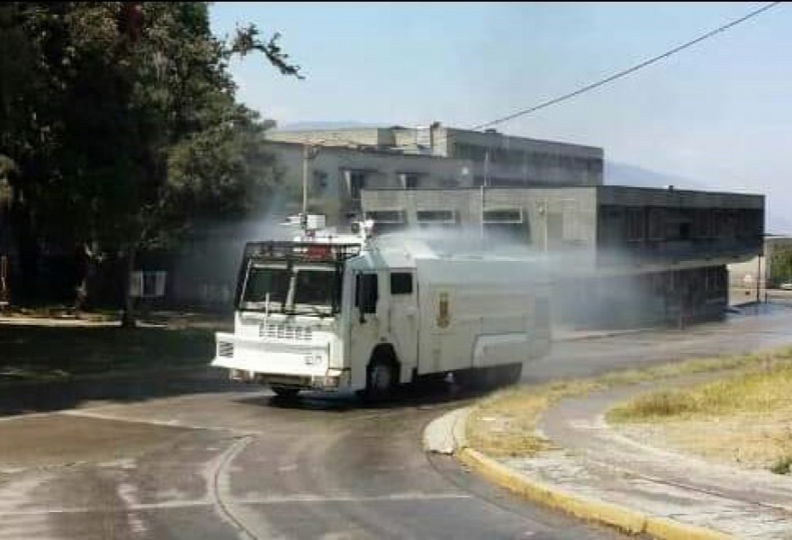 A disinfecting vehicle sprays the surrounding area outside the IAHULA central hospital in Merida City, Merida State on Sunday. (Juan Carlos Uzcagetui)