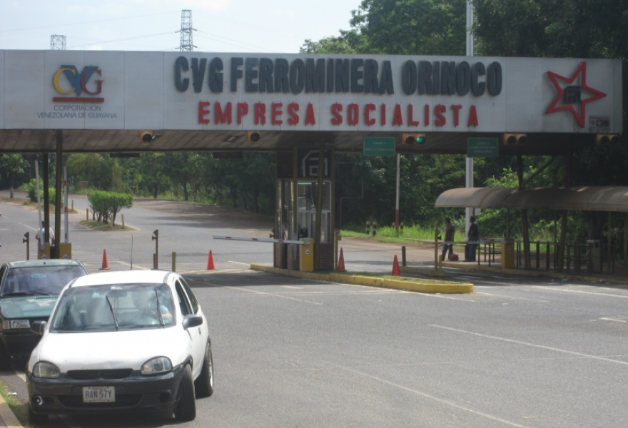 "The entrance to Ferrominera, which states the company is a ""Socialist Corporation"" (Ewan Robertson, April 2011)"