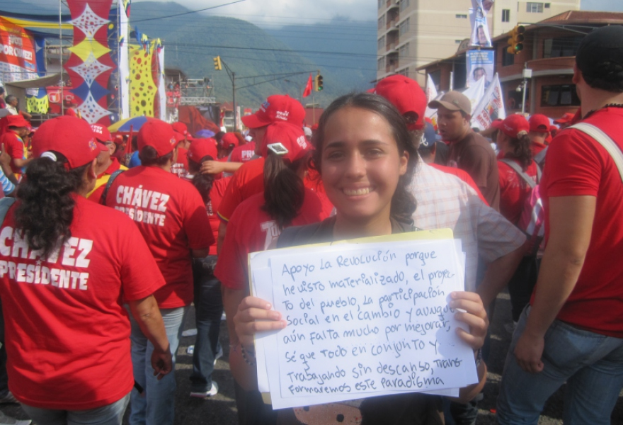 "A young activist explains why she supports Venezuela's Bolivarian revolution at a mass pro-Chavez rally: ""I support the revolution because I've seen the people's project and participation in social change materialised"" (Ewan Robertson)"