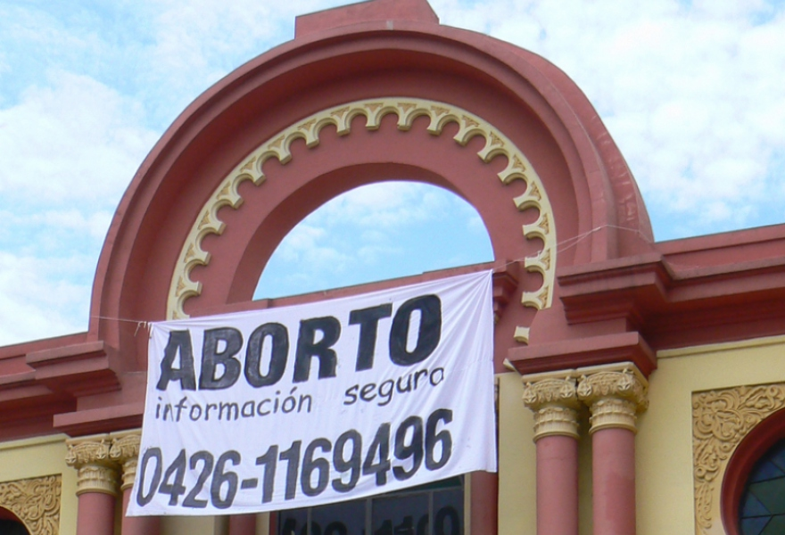 A banner promoting the abortion information line (archive)
