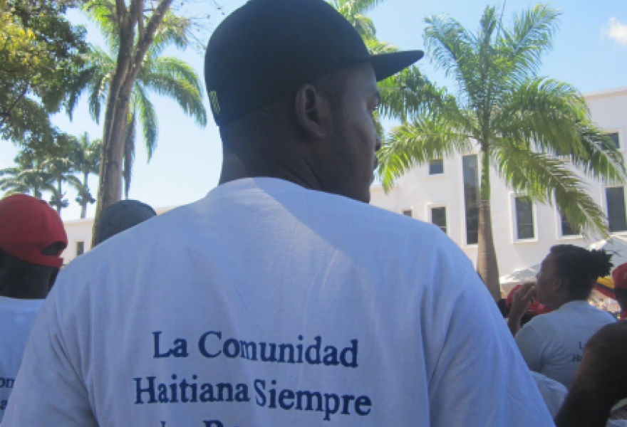"One of numerous Haitian solidarity activists with a t-shirt reading ""the Haitian community will always remember him"" (Ewan Robertson / Venezuelanalysis.com)"