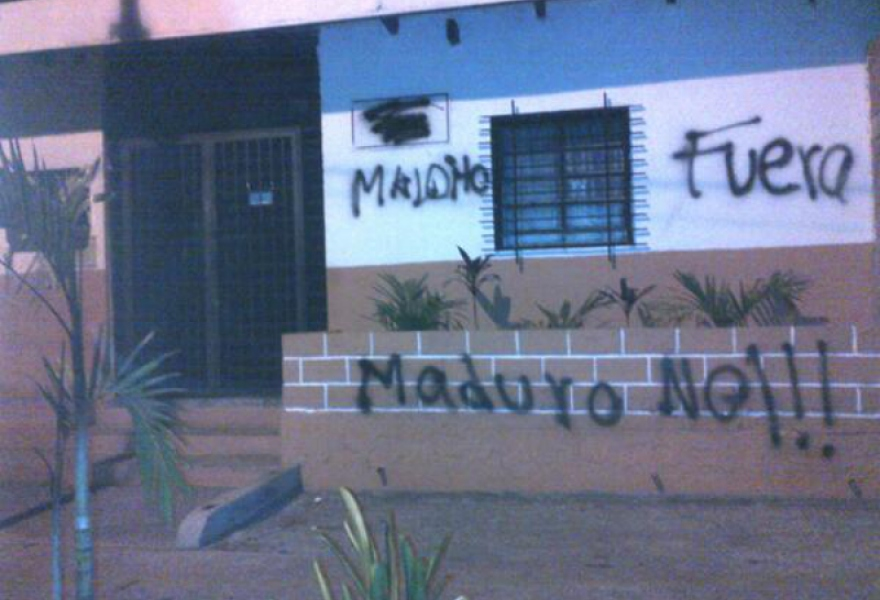 "A government health clinic in the state of Miranda that was vandalized by opposition groups. The message says ""D---head, out. No to Maduro!!!"""