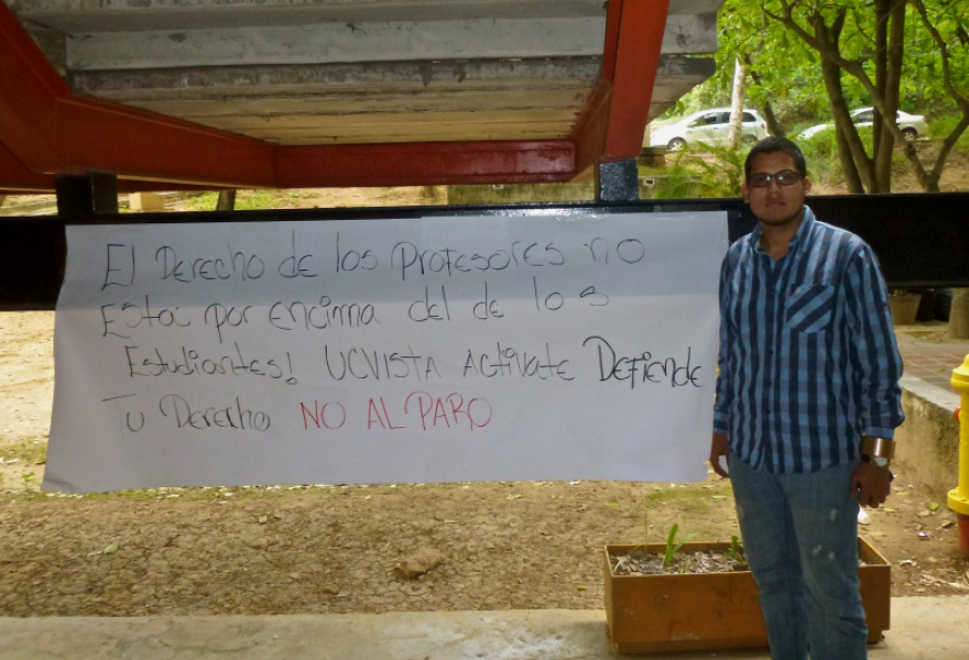 "Education student Jhonatan Sayago put up posters against the strike at the UCV. ""The strike is not a legitimate way for the professors to demand their rights,"" he said, ""because they're violating ours"" (Sascha Bercovitch/ Venezuelanalysis.com)"