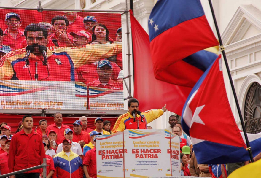 "President Nicolas Maduro speaking at Saturday's rally. The podium reads ""To fight corruption is to build a [new] country]"" (Minci)."
