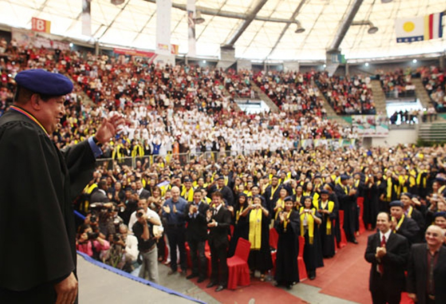 "Hugo Chavez with the first wave of graduates from comprehensive community medicine, Febuary 2012. The late Venezuelan president urged community doctors to be ""social leaders"" and ""doctors of socialism"" (agencies)"