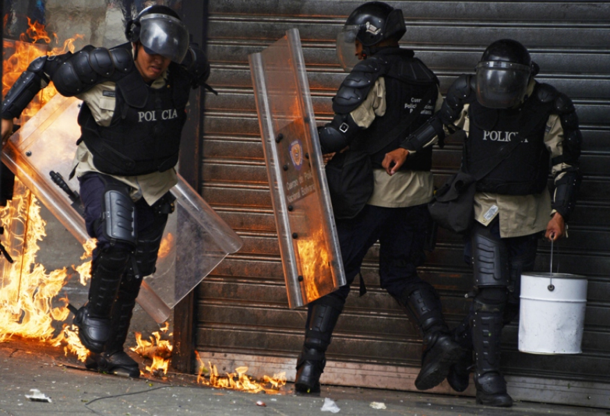 A photograph circulated by Rodriguez that reportedly shows police being attacked by opposition groups on Thursday (Juan Barreto/AFP)