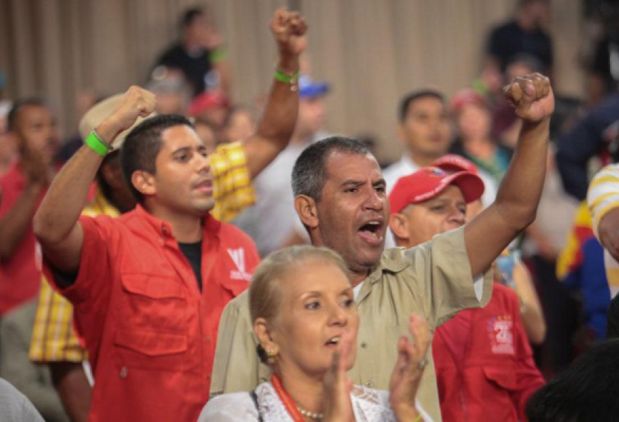 Workers and party members cheer on Maduro's announcement of the Workers' Bank at Miraflores palace. (Presidential Press)