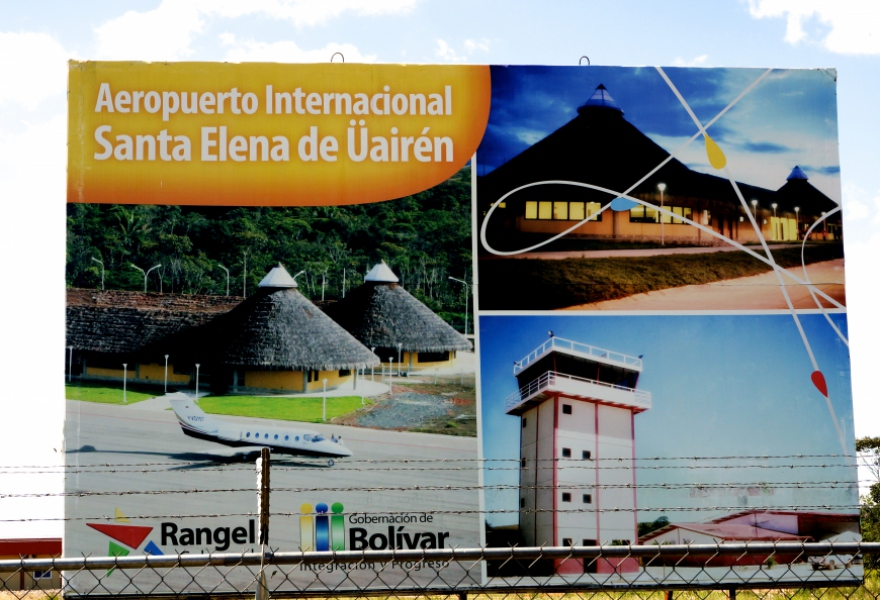 A large billboard depicting the airport structures