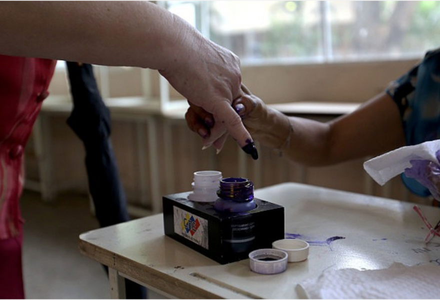 "The iconic ""purple pinky"" which prevents votes being cast twice (AVN)"