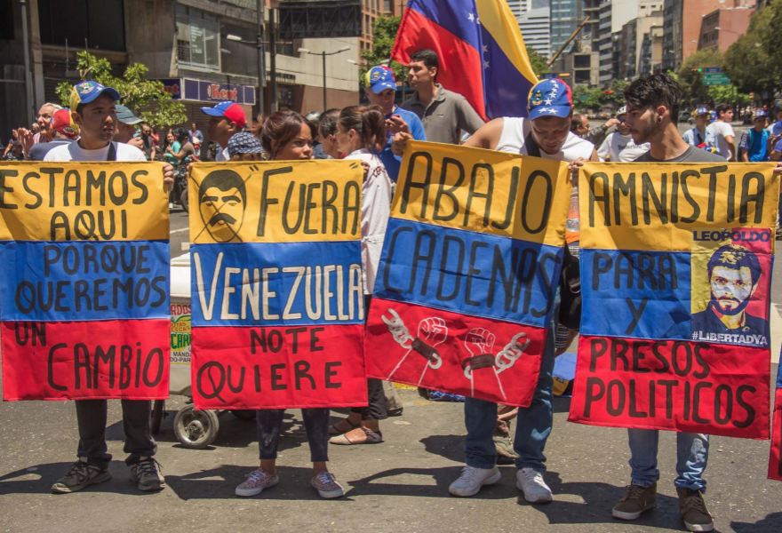 """The opposition march - """"We are here because we want change,"""" """"Get out! Venezuela doesn't want you!,"""" """"Down with chains,"""" """"Amnesty for political prisoners"""" (From left, Alba-TV)"""