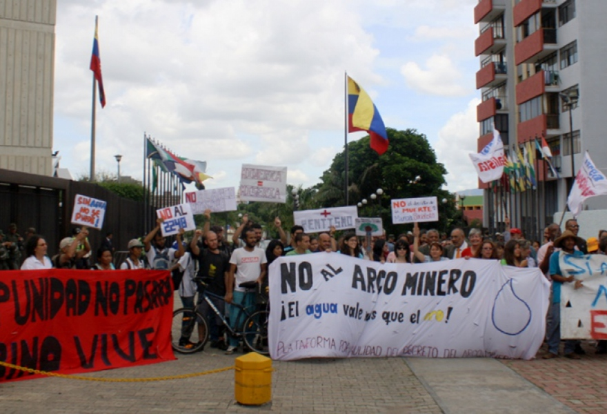 "Banners read left to right: ""Impunity will not happen! Sabino Lives!"", ""No to the Mining Arc! Water is more valuable than gold!"", ""Yes to life, No to ecocide"". (Sergio Álvares)"
